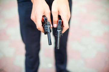 Two pistols in hand men