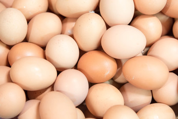 close up pile of fresh chicken eggs in the market