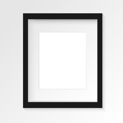 Black vertical photo frame on gray wall with realistic shadows. Vector illustration. EPS10.