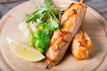 Salmon skewer with soy sauce