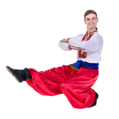 young man wearing a folk russian costume dancing against isolated white with copyspace