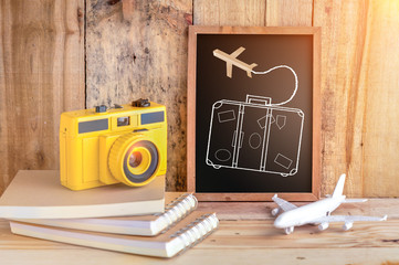 travel concept with drawing of suitcase on chalkboard