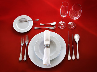 Table setting on red background