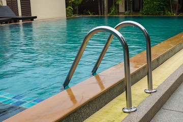 Swimming pool with stair close up