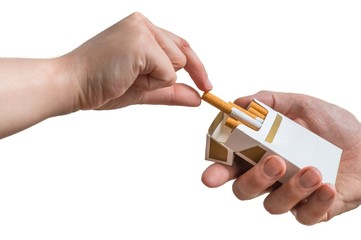 Hand is taking cigarette from cigarette pack an accepting an offer