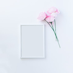 Empty picture frame with pink roses, top view