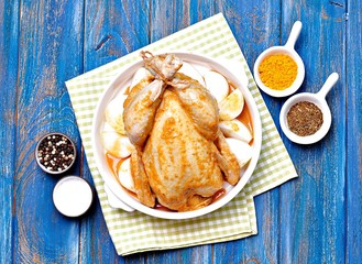 Raw chicken marinated with spices and onions.