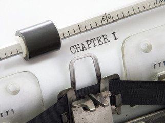 """closeup of an typewriter with the words """"CHAPTER 1"""""""