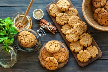 peanut butter and honey cookies on a dark wood background. selective focus