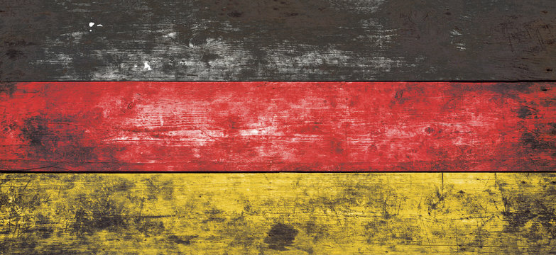 German flag painted on old wood plank background.