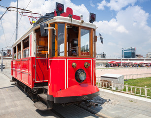 Old red tram goes on Taksim square