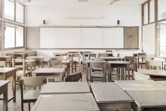 Classroom / Empty disorderly classroom in the morning. Vintage style.