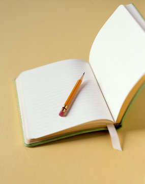 Pencil on open lined paper notebook