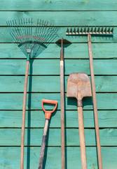 Garden instruments on wooden background