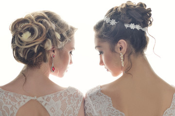 Two beautiful bride posing together