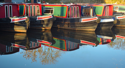 Narrow boats moored at Wrenbury on the Llangollen canal, boats and reflections