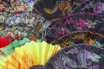 Colorful  fans at an outdoor market.