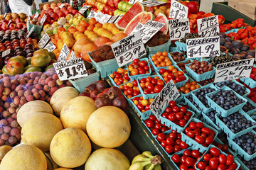 Colorful berries, melons, oranges and vegetables at an outdoor market in Seattle.
