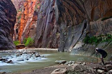 Photographer standing in the Narrows of Zion