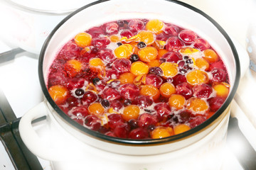 Cooked fruits plums and cherries for a drink