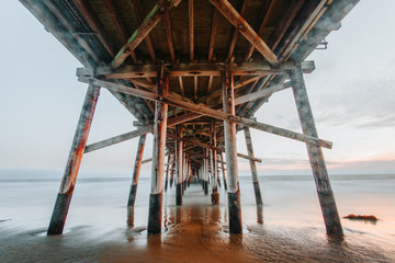 View under wooden pier on beach