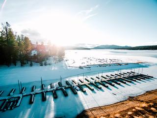 Frozen lake with boat moorings