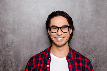 Funny young man in glasses showing his white smile