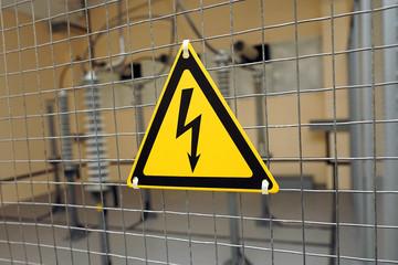 Yellow triangular sign of electrical hazards.