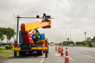 people is working on crane