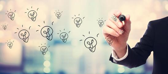 Light Bulb concept with businessman