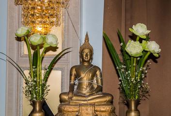 buddha statue with lotus