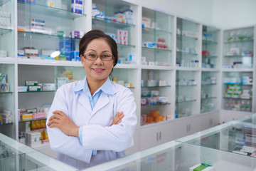 POrtrait of confident Asian pharmacist smiling at camera