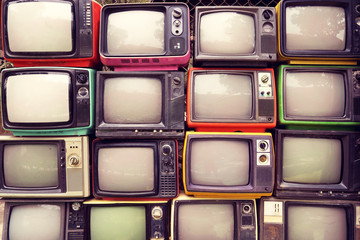 Poster Retro Pattern wall of pile colorful retro television (TV) - vintage filter effect style.