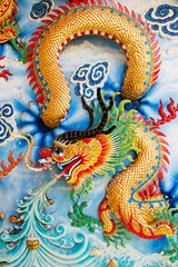 Golden dragon on Chinese temple wall