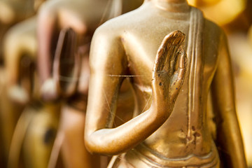 Hands of buddha statue in temple Thailand.selective focus