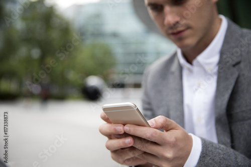 Image result for picture of a man checking his phone for messages at the office