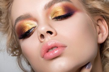 Close up beauty portrait of young woman with summer makeup