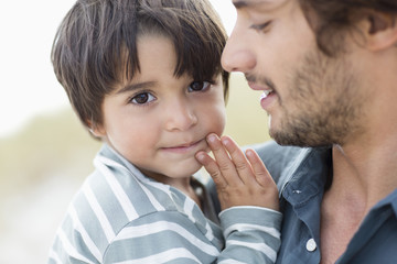 Close-up of a boy with his father