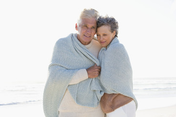 Old couple embracing each other on the beach