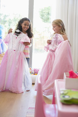 Two little girls shopping at clothing store