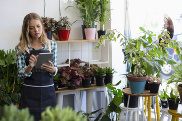 Florist using tablet in her shop