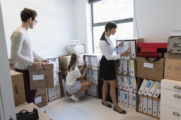 Design professionals working in storage compartment