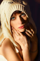 Woman in a shawl looks up with her deep blue eyes