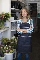 Florist standing with her arms crossed in her shop