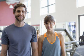 Portrait of a happy couple in a gym