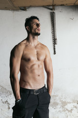 Muscular Fit Man Standing Outside