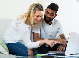 Couple browsing web at home.