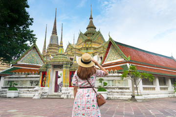 Tourist is traveling into Wat Pho is one of famous attractive place to visit in Bangkok, Thailand.