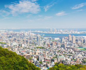 Kobe cityscape and skyline with port view from mountain.