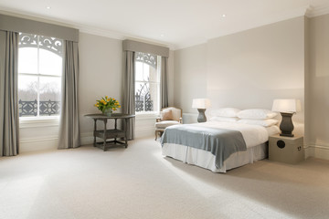 Generous double bedroom with large sash windows and high ceilings.
